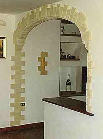 Mobili lavelli archi interni rivestiti in pietra for Mattoni finti per interni